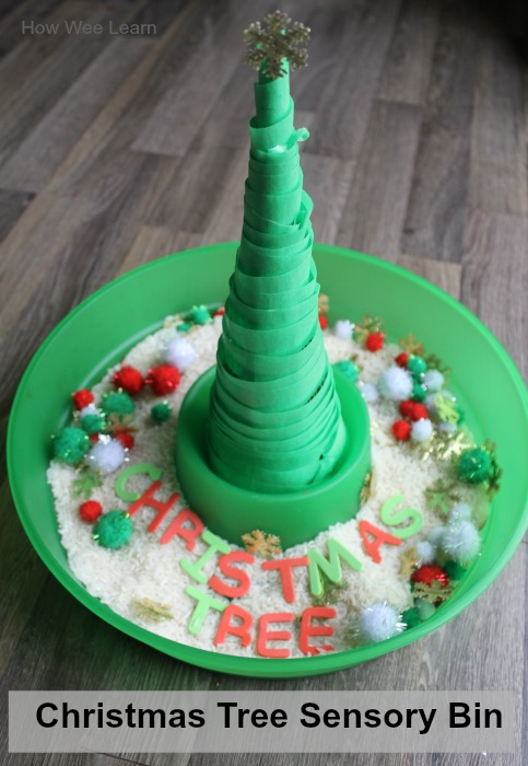 Christmas sensory bin with a christmas tree to decorate