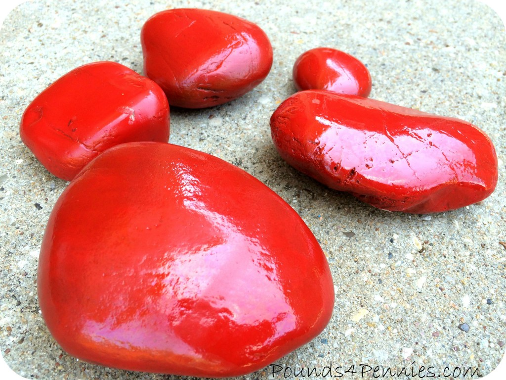Add a little whimsy make a painted ladybug garden rock for Spray paint rocks for garden